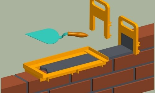 Использование специального приспособления для кладки кирпича